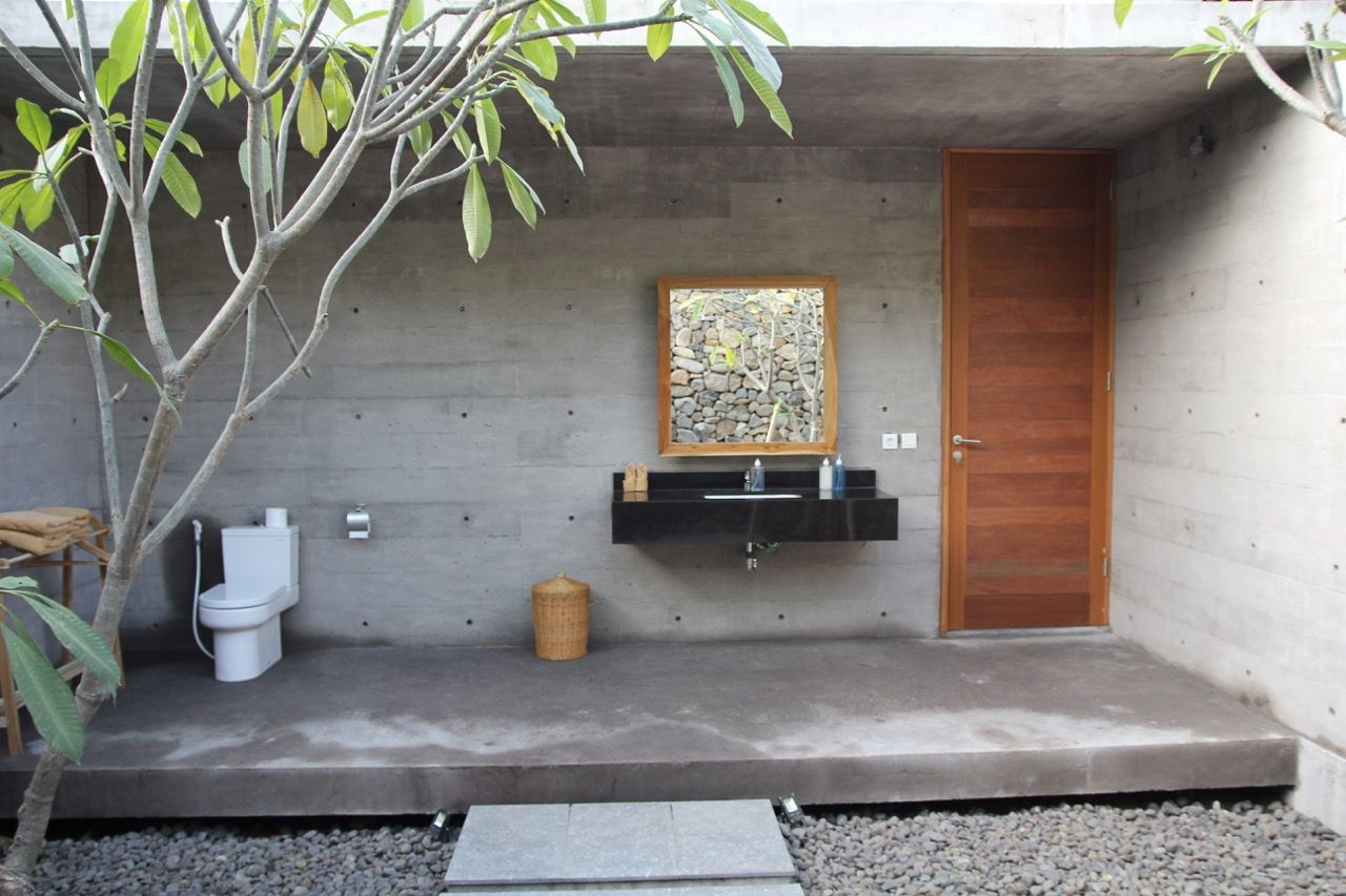 Take a shower under the frangipani trees in one of the semi open bath rooms (42 m2).