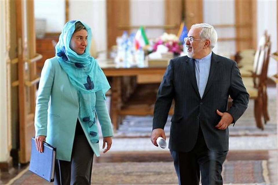 Iranian Foreign Minister Mohammad Javad Zarif, right, and the - invitation issued by the russian foreign ministry