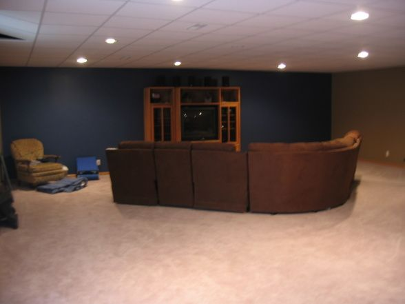 Accent wall in living room navy blue apartment decor for Paint ideas for basement family room