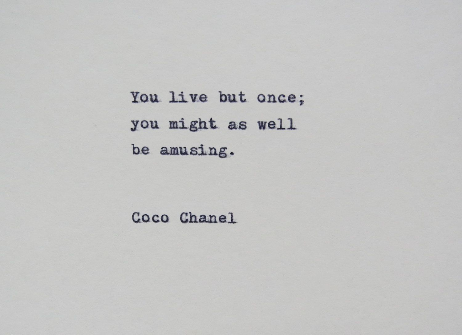 Coco Chanel Quote Typed on Typewriter on Cardstock