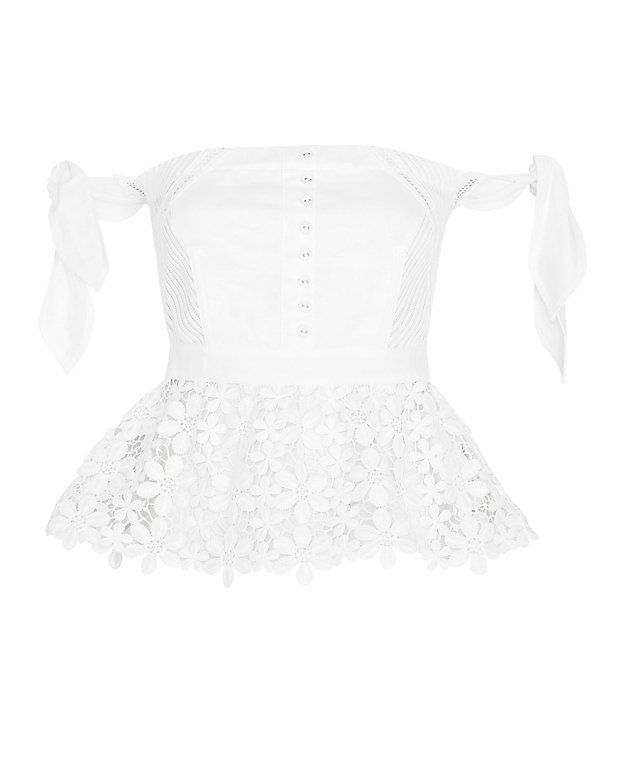 Self-Portrait Peplum Lace Corset: White: Sleeveless self tie shoulder straps. Button details at front and zipper closure at back. Lace peplum. Semi sheer. In white. Model Measurements: Height 5'10 1/2; Waist 24 ; Bust 31 Length from shoulder to hem: ...