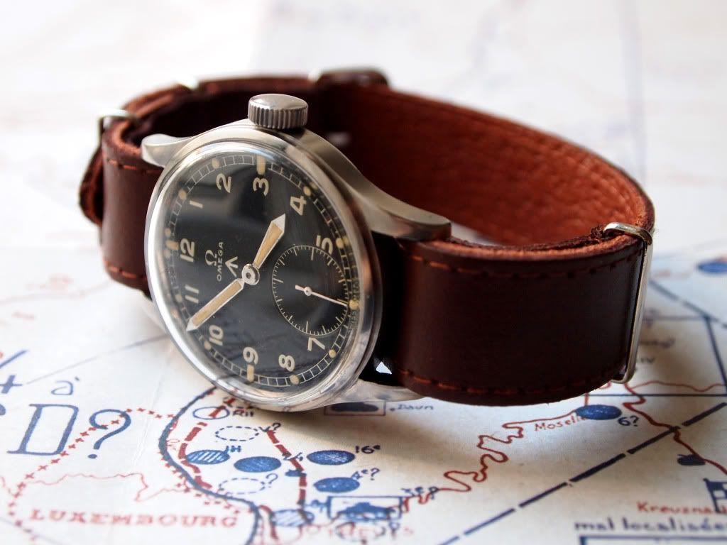 Black dial vintage Omega with brown strap