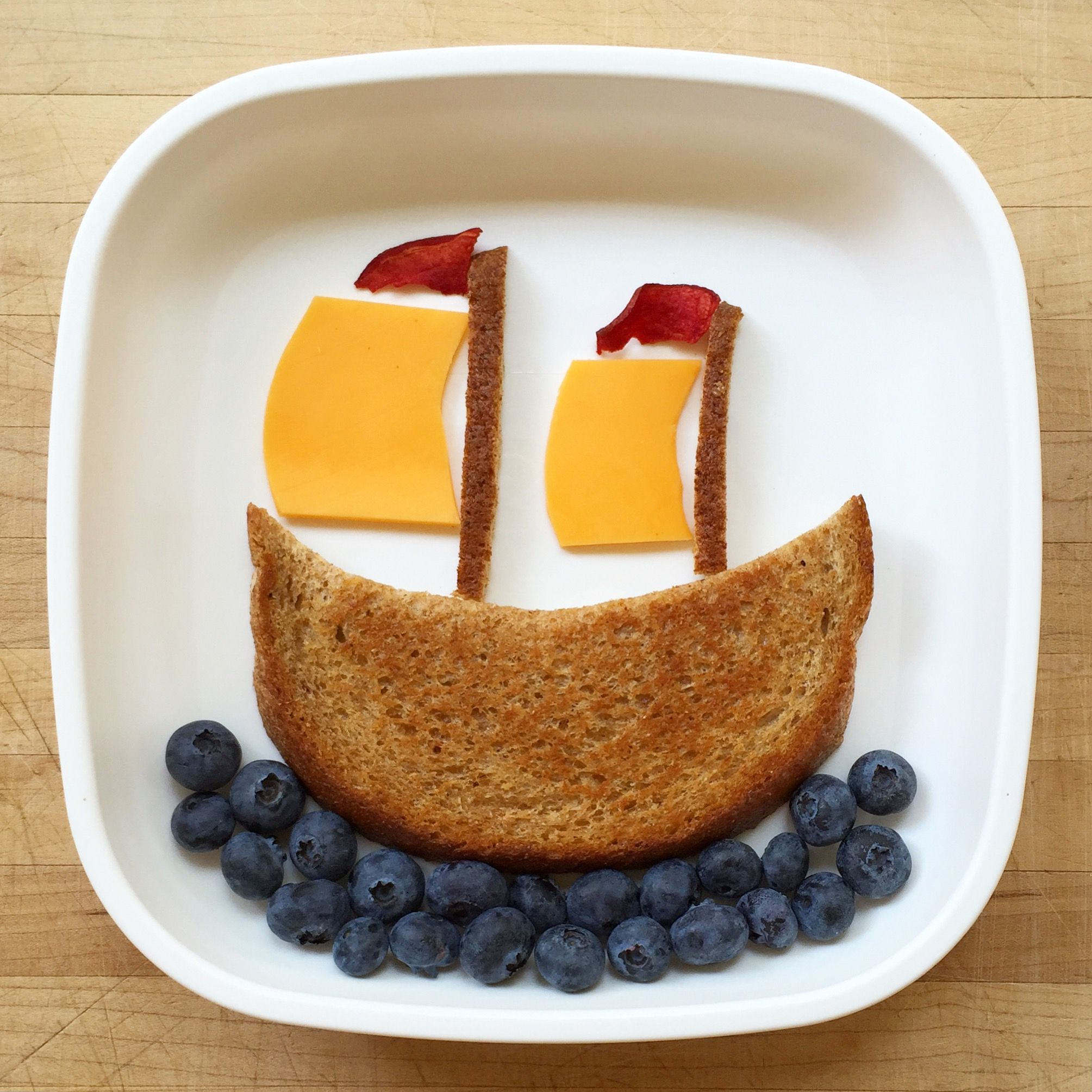 Supplies: Scissors Replay plate Ingredients: 1 slice bread, toasted ¼ cup blueberries 1 slice yellow cheese 2-3 beet chips TIP: You won't use them all, but