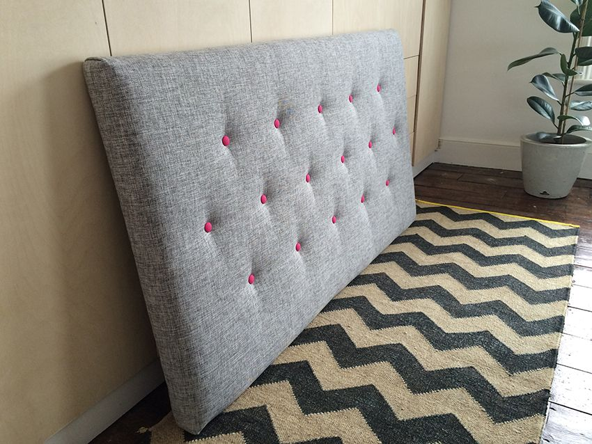 An Upholstered Kingsize Headboard In Grey Fabric With Bright Fuchsia Contrast Ons