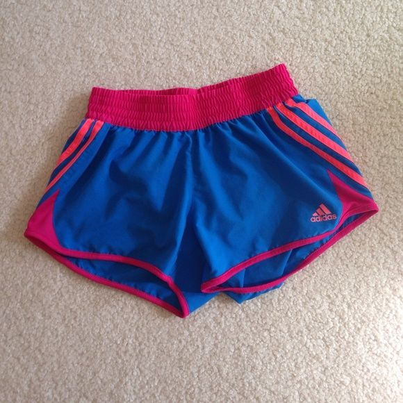 Adidas active shorts Blue with pink and neon coral stripes! I've only used them twice. There's a tiny hidden pocket on the inside for your keys (I assume)  MAKE A REASONABLE OFFER if you don't like the price! Adidas Shorts