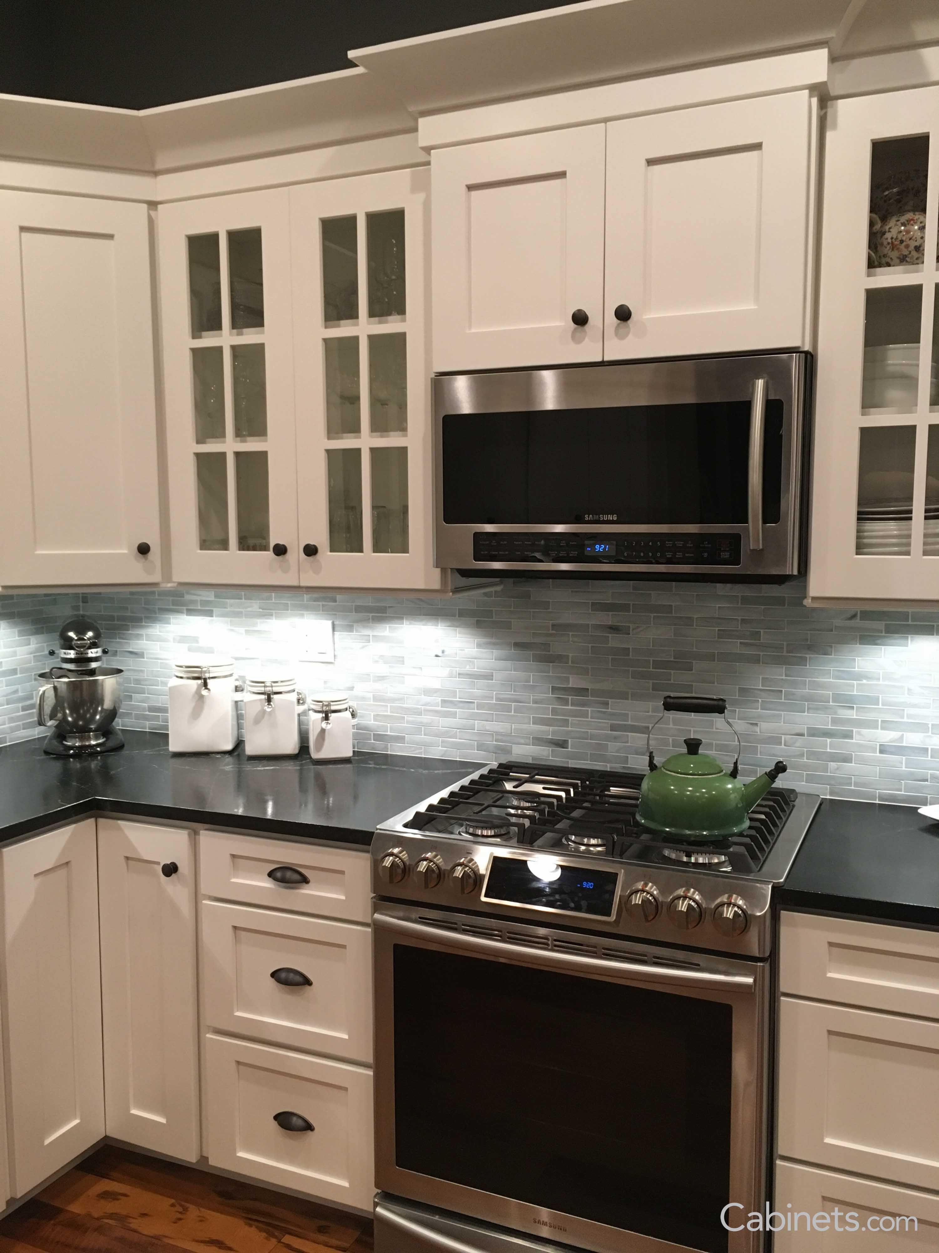 The picture features Shaker II Maple Bright White Cabinets