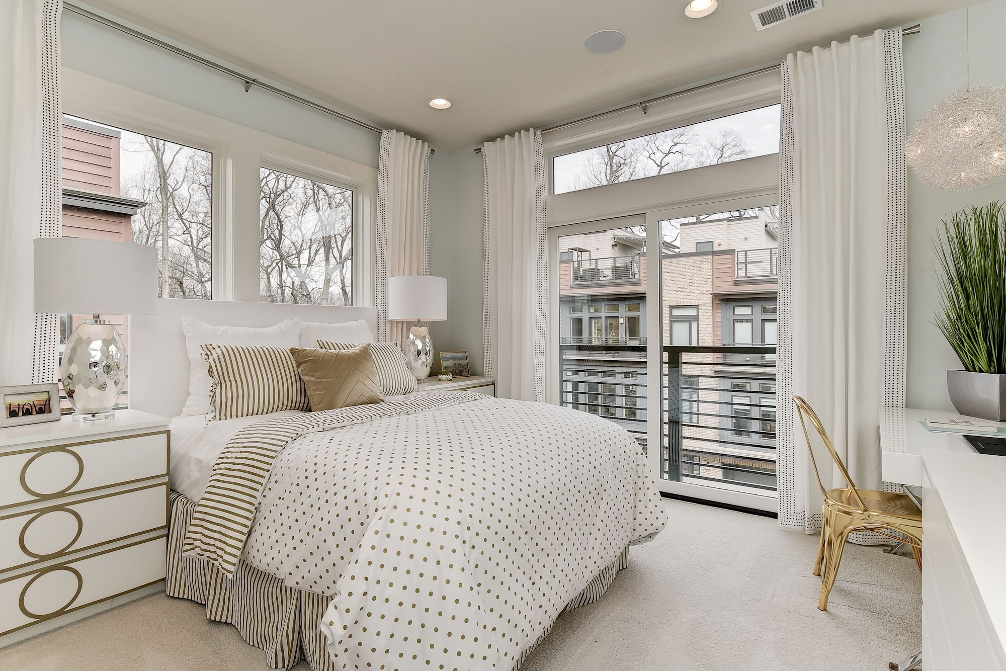 Bright Modern White Bedroom With Gold Accents In Eya S Cameron Model At Grosvenor Heights In Bethesda Md C White Bedroom Modern Living Room On A Budget Home
