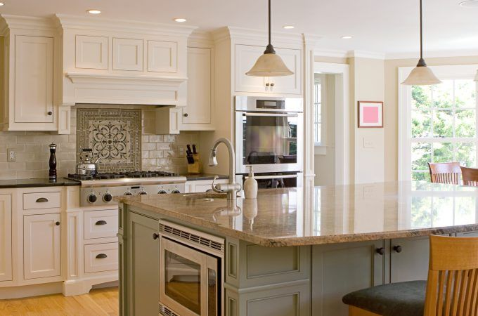 Cream Two Tone Kitchen Cabinets With Brown Granite Countertop And Pendant Lig Traditional White Kitchen Cabinets Kitchen Inspirations White Kitchen Traditional