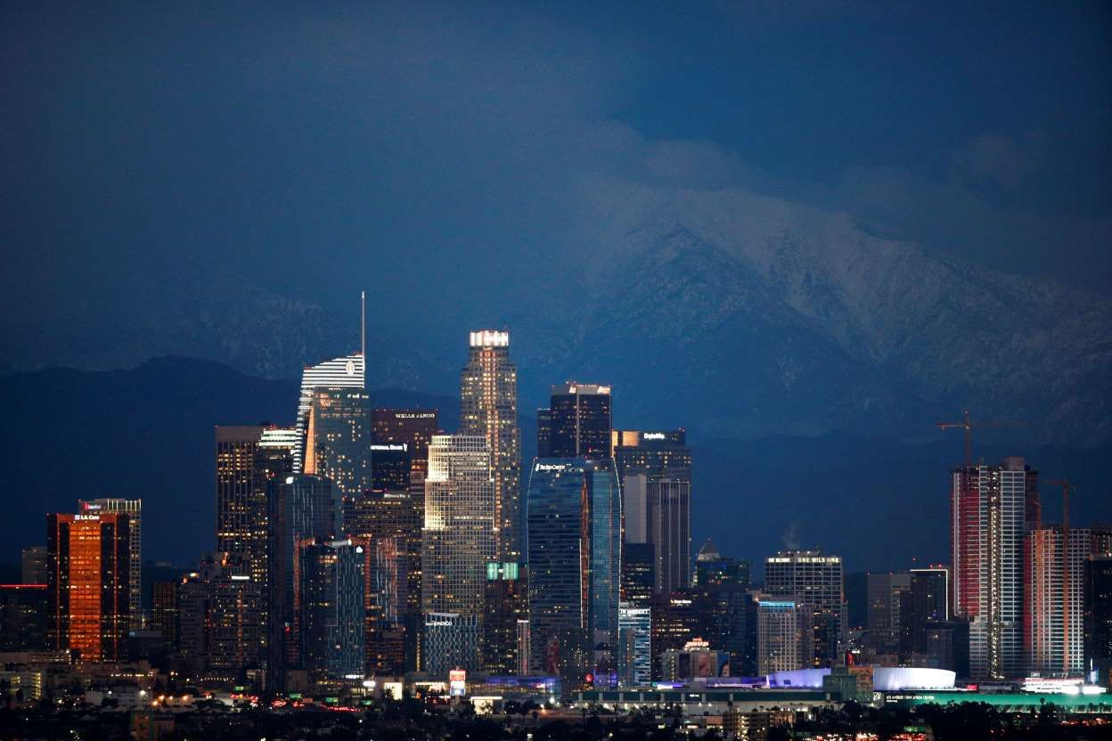 Snow Capped Mountains Are Seen Behind The Los Angeles Downtown Skyline At Dusk Thursday Feb 21 2019 In Los Winter Weather Advisory Winter Weather Skyline