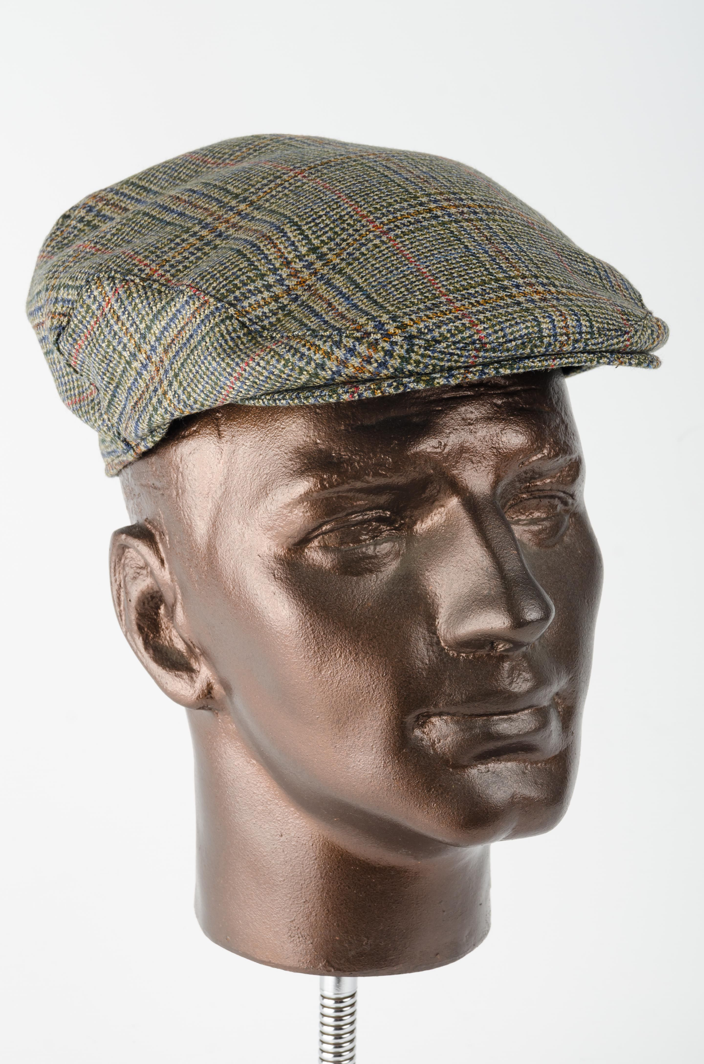 729add297 This beautifully textured staple flat cap is produced from a ...