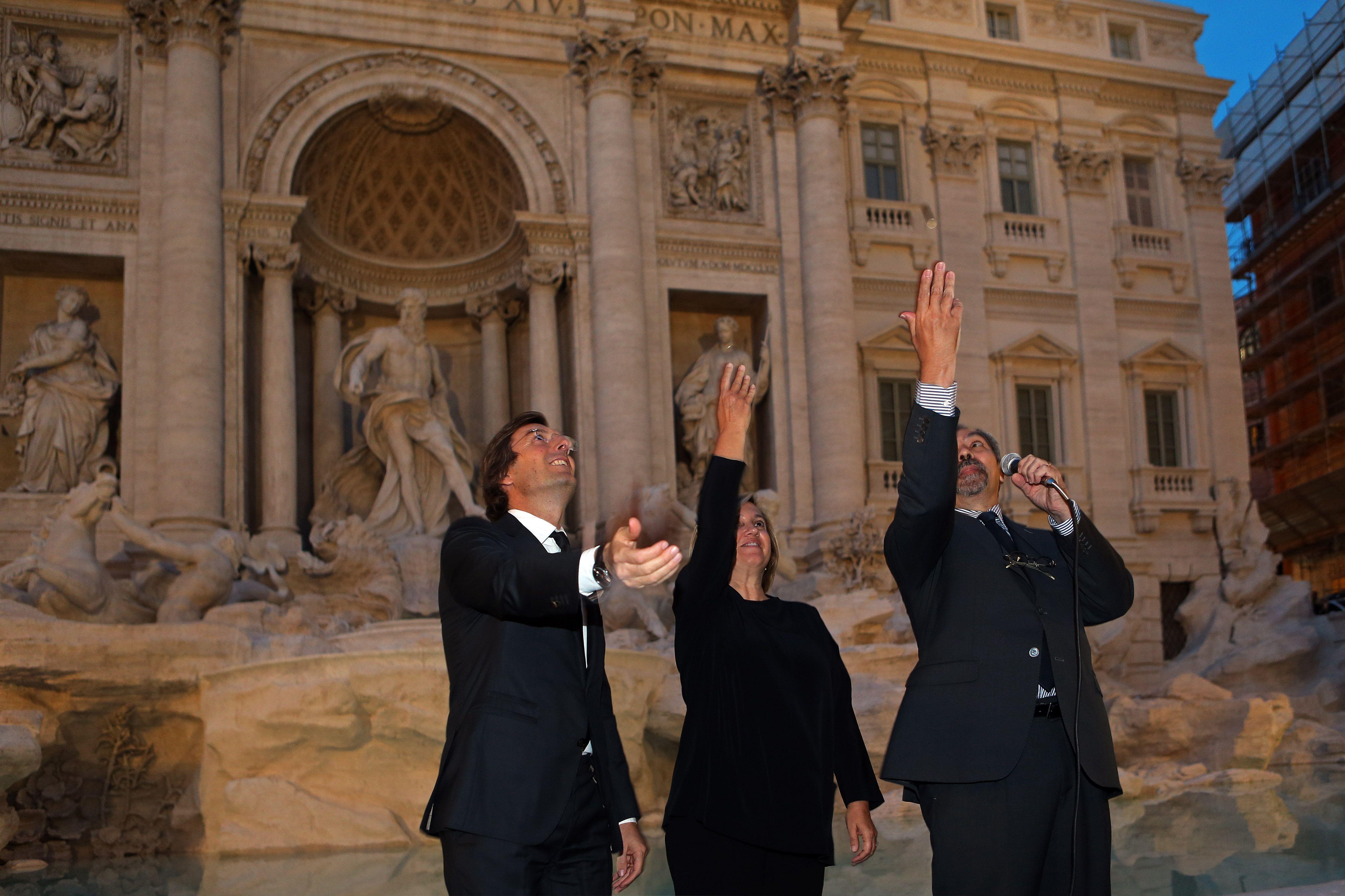 Pietro Beccari, Silvia Venturini Fendi and Claudio Parisi Presicce at the Trevi Fountain inauguration ceremony for the Fendi for Fountains project