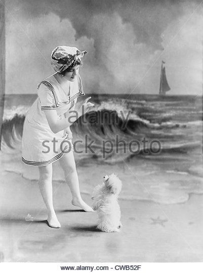 bathing-beauty-young-woman-in-bathing-suit-with-small-dog-in-front-cwb52f.jpg (401×540)