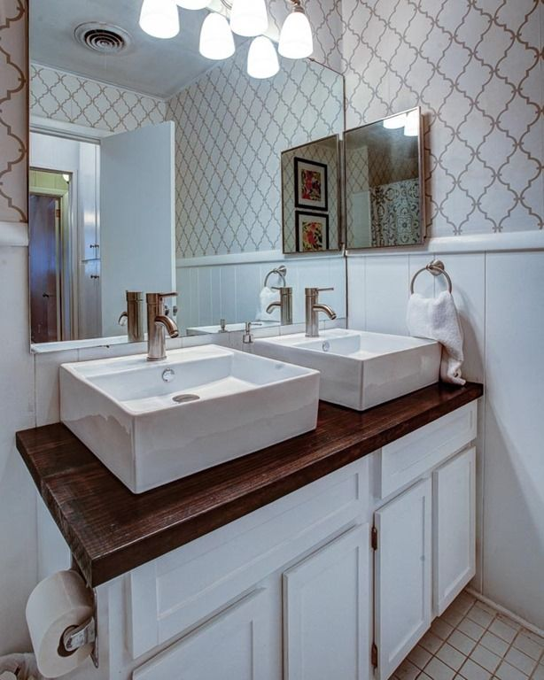 Live The Home Life Hall Bathroom Wallpaper Wood Countertop Vessel Sinks White Cabinets