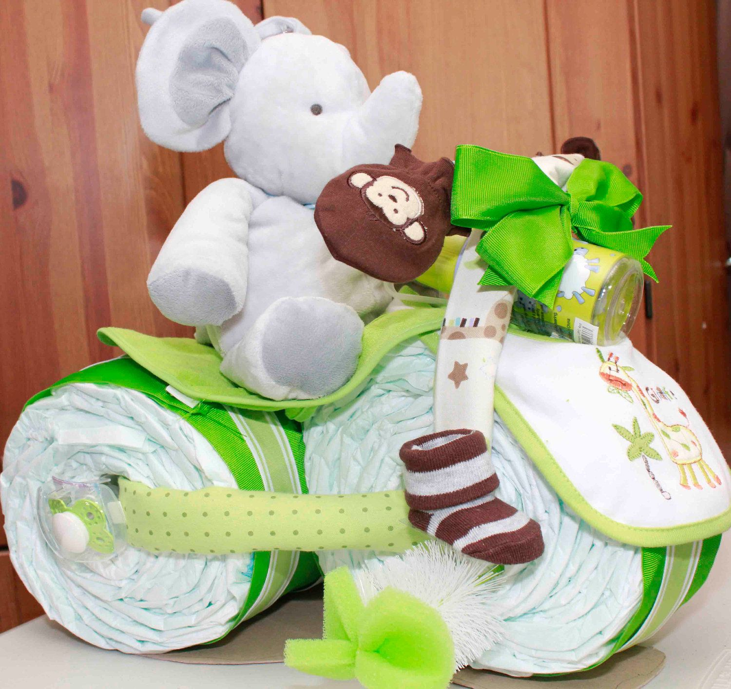 Awesome Gift Loaded Unique Green Safari Jungle Animal Theme Tricycle Gender Neutral Diaper Cake. $98.00, via Etsy.