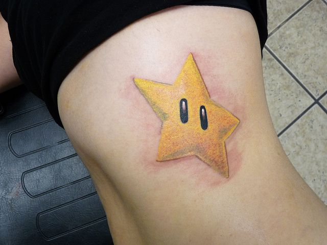 Get Powered Up With These 28 Amazing Super Mario Tattoos ... |Mario Star Tattoo