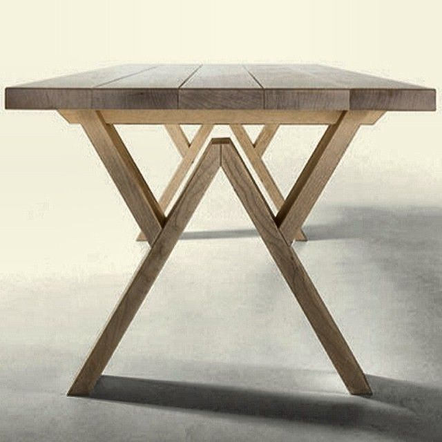 Great dining table design with interesting legs