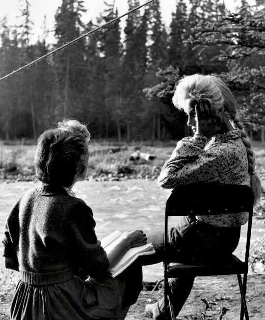 "Great shot of Marilyn and her drama coach Natasha Lytess on the set of ""River of No Return"" in 1954."