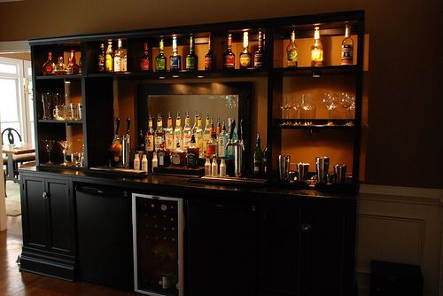 back wall of bar - like the cabinets with the glass door ...