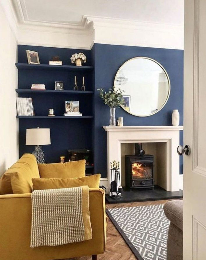 living room in victorian terrace house navy blue and