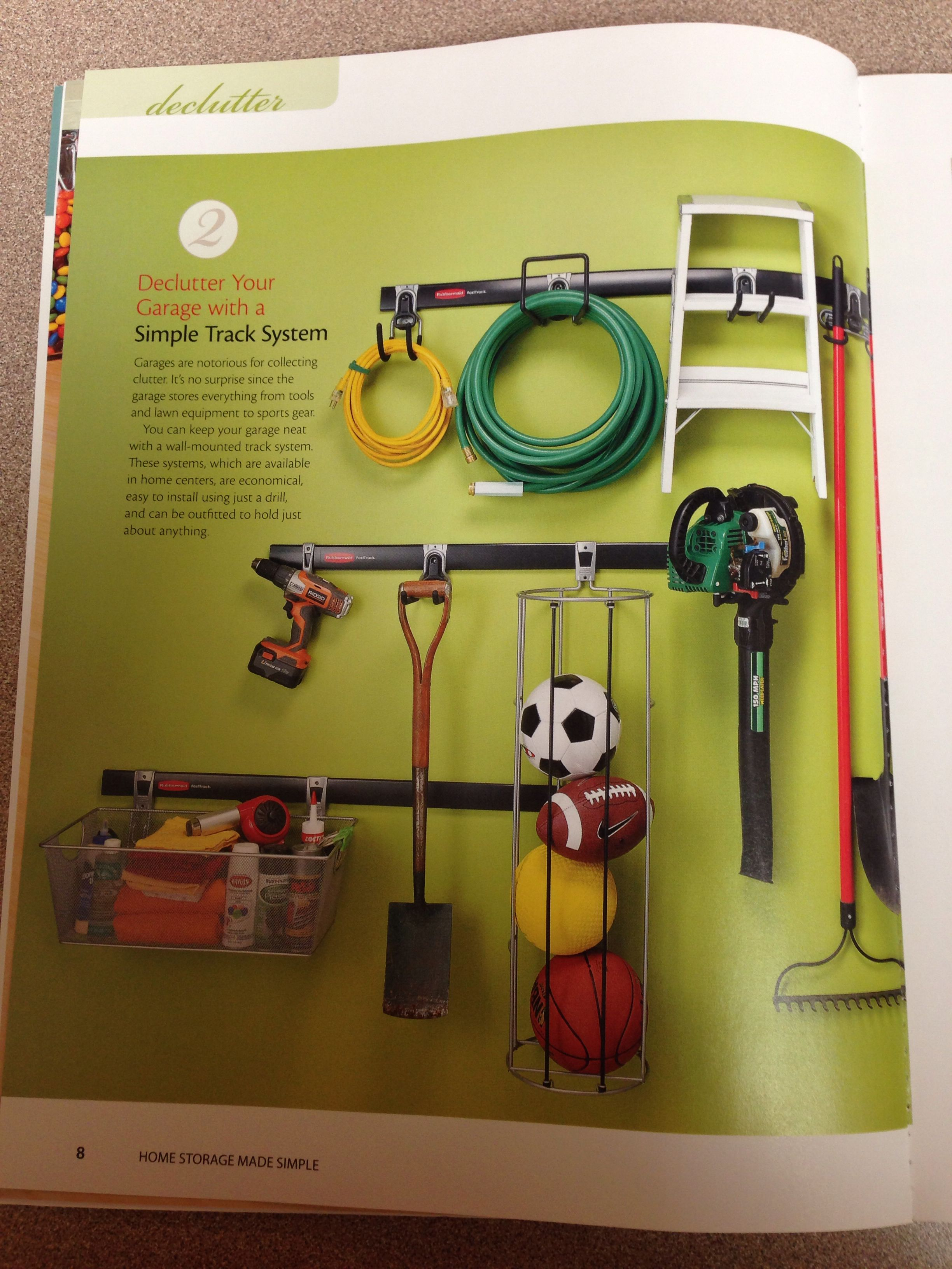 Rubbermaid track system for garage. Have this on the wall and it\'s ...