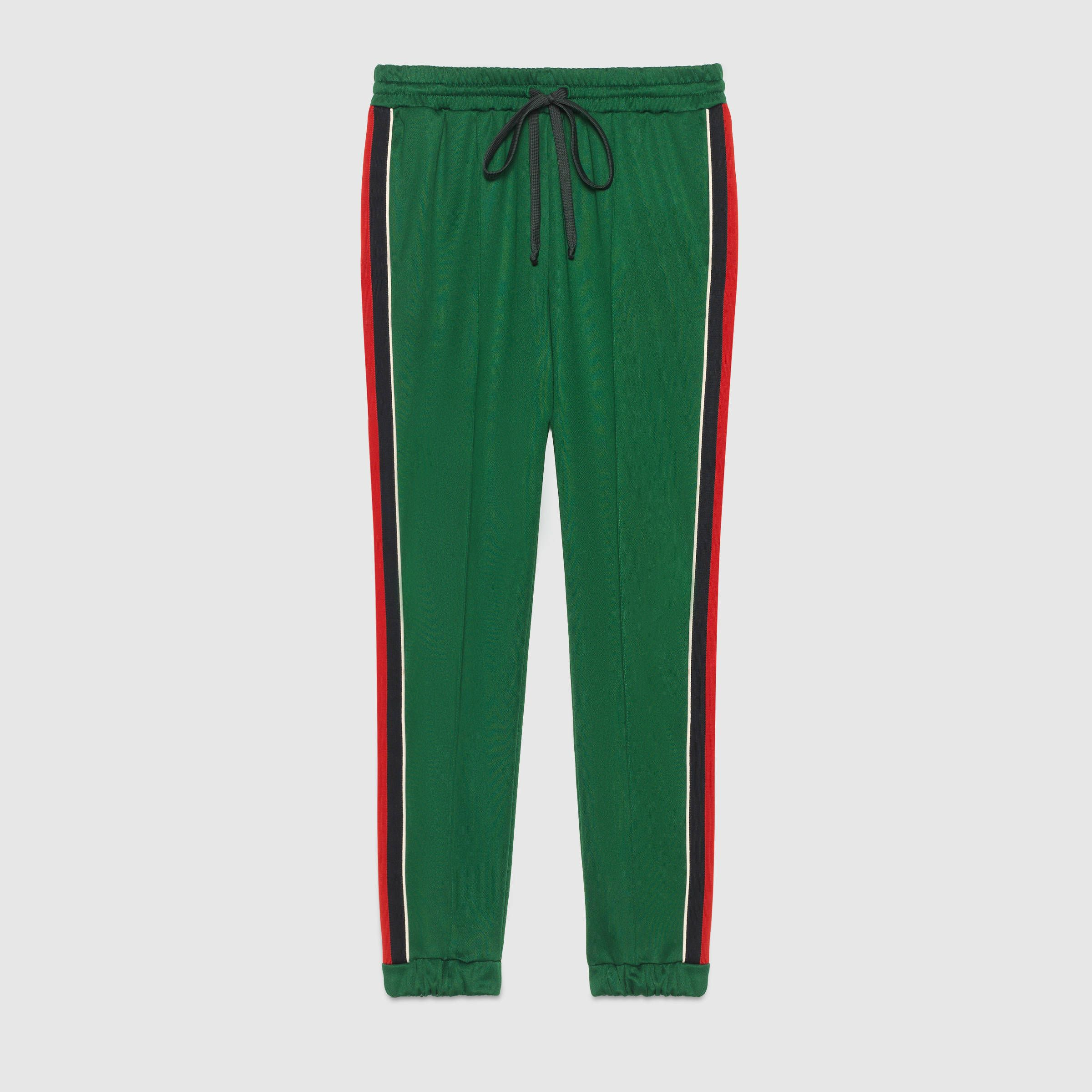 gucci pants. shop the technical jersey jogging pant by gucci. a in green. activewear is an important theme continued throughout gucci pants