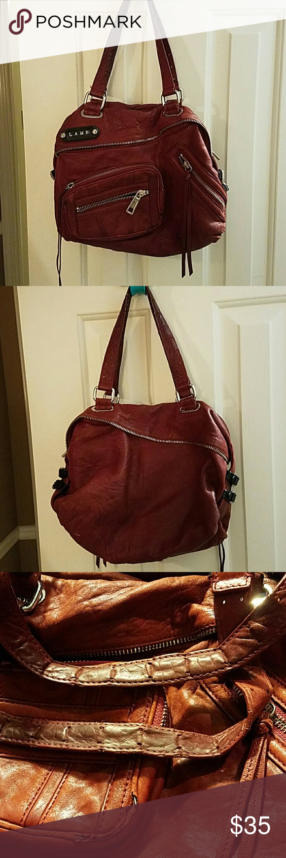 L.A.M.B Handbag Burgundy authentic L.a.m.b. bag all zippers working a day flaws are shown in the pictures. Good price reflects flaws but the bag is very clean inside. L.A.M.B. Bags