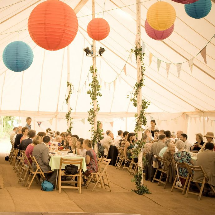 Wedding Lanterns And Flowers Decorate This Huge Marquee