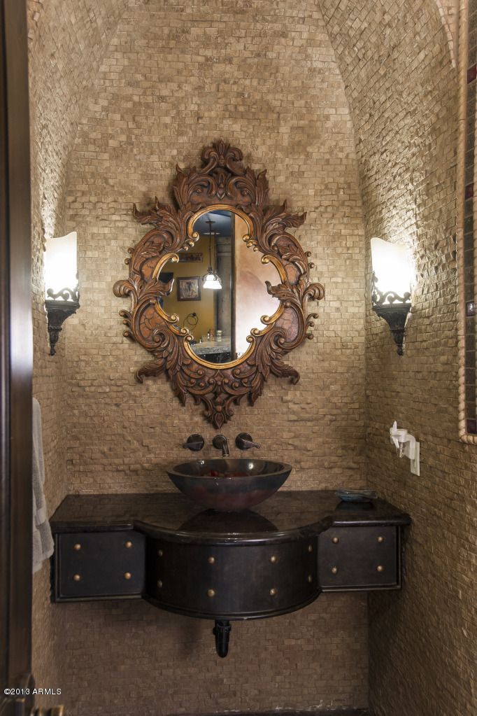 Powder room.. I'd change the lighting to a simple rustic pendant light set above the sink/mirror