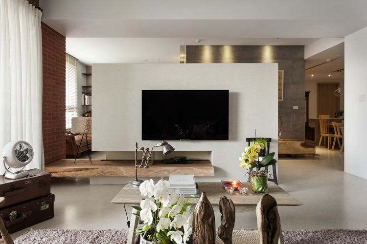 Ein Minimalistischer Stil In Weiss Und Holz Fur Die Wohnwand Im Wohnzimmer