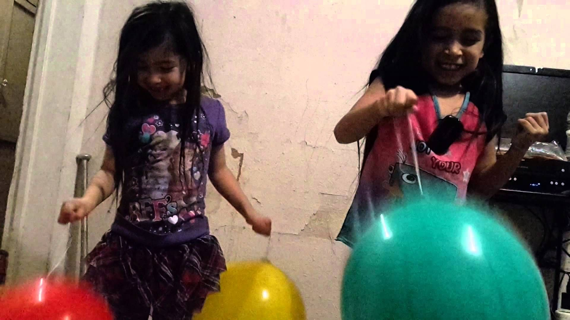 Kids playing with Punch balloons