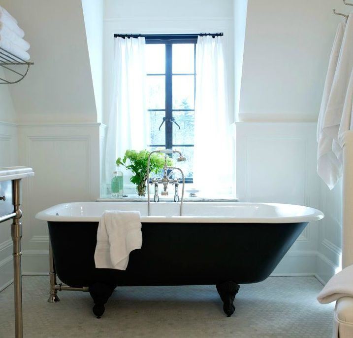 lovely chic bathroom with cast iron claw foot tub marble hex tiles floor and white