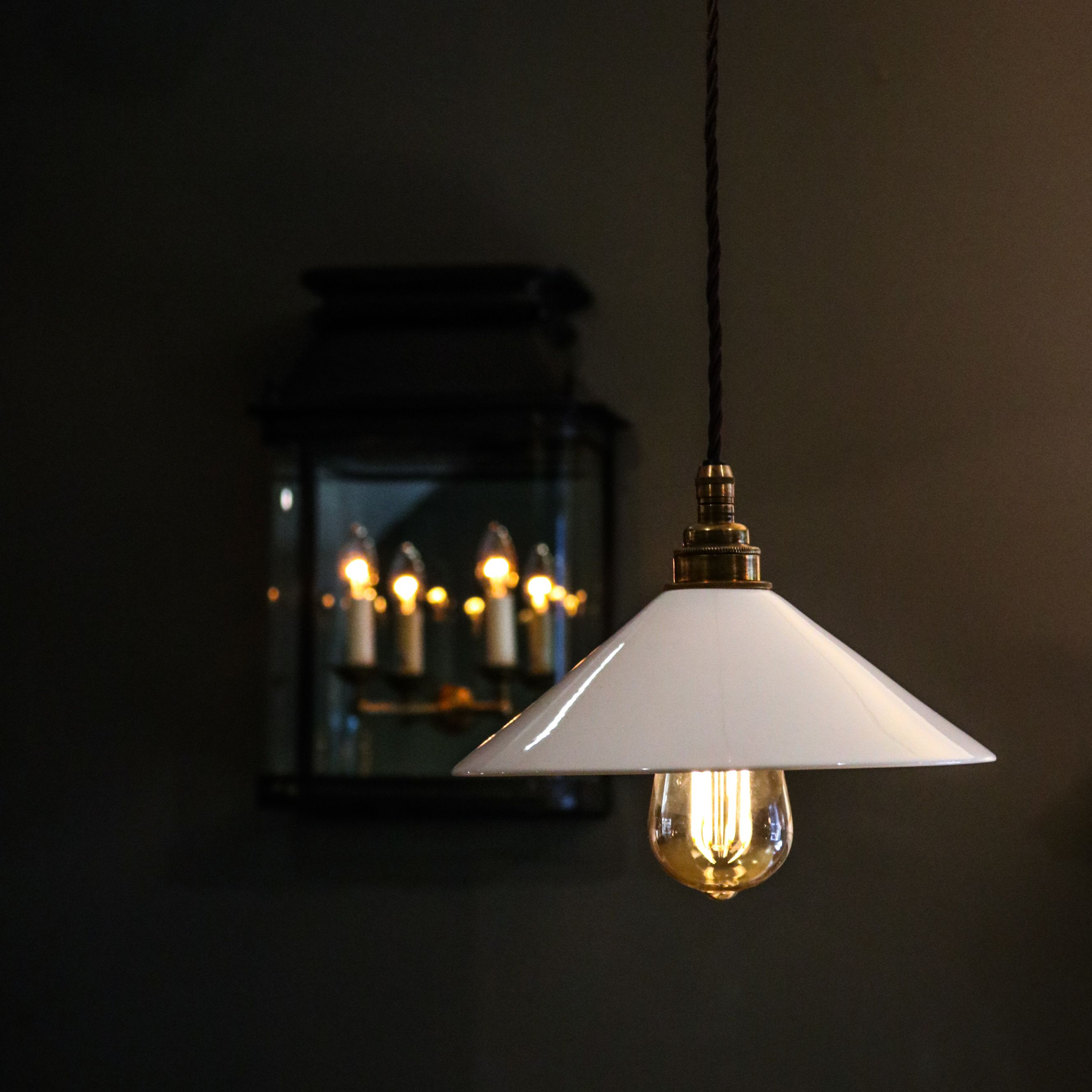 The margot wall light and the hanging kick light with glass coolie