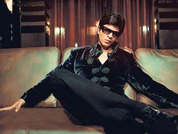 Shahrukh Khan in a black velvet David Tang jacket for the