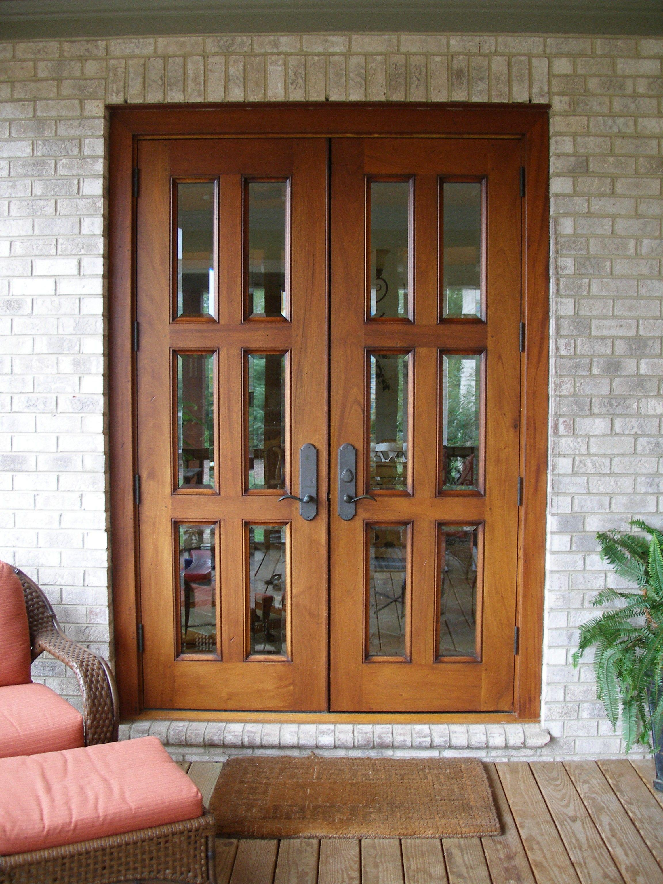 Exterior Double Brown Wooden Patio Doors With Black Metal Handles