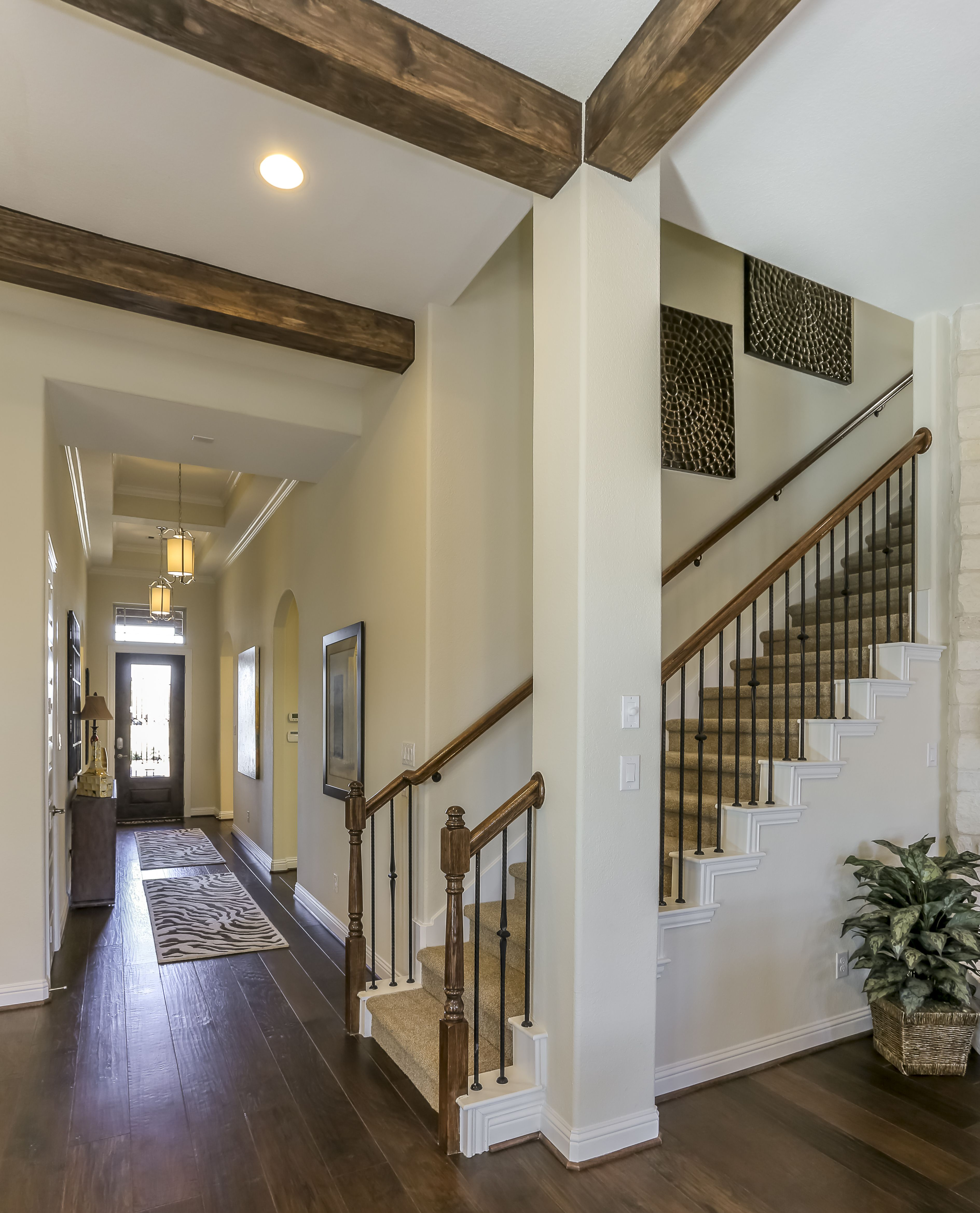 Gehan Homes Stairway  Carpet Tread, Medium Hardwood Flooring, Medium Rustic  Beam Ceilings