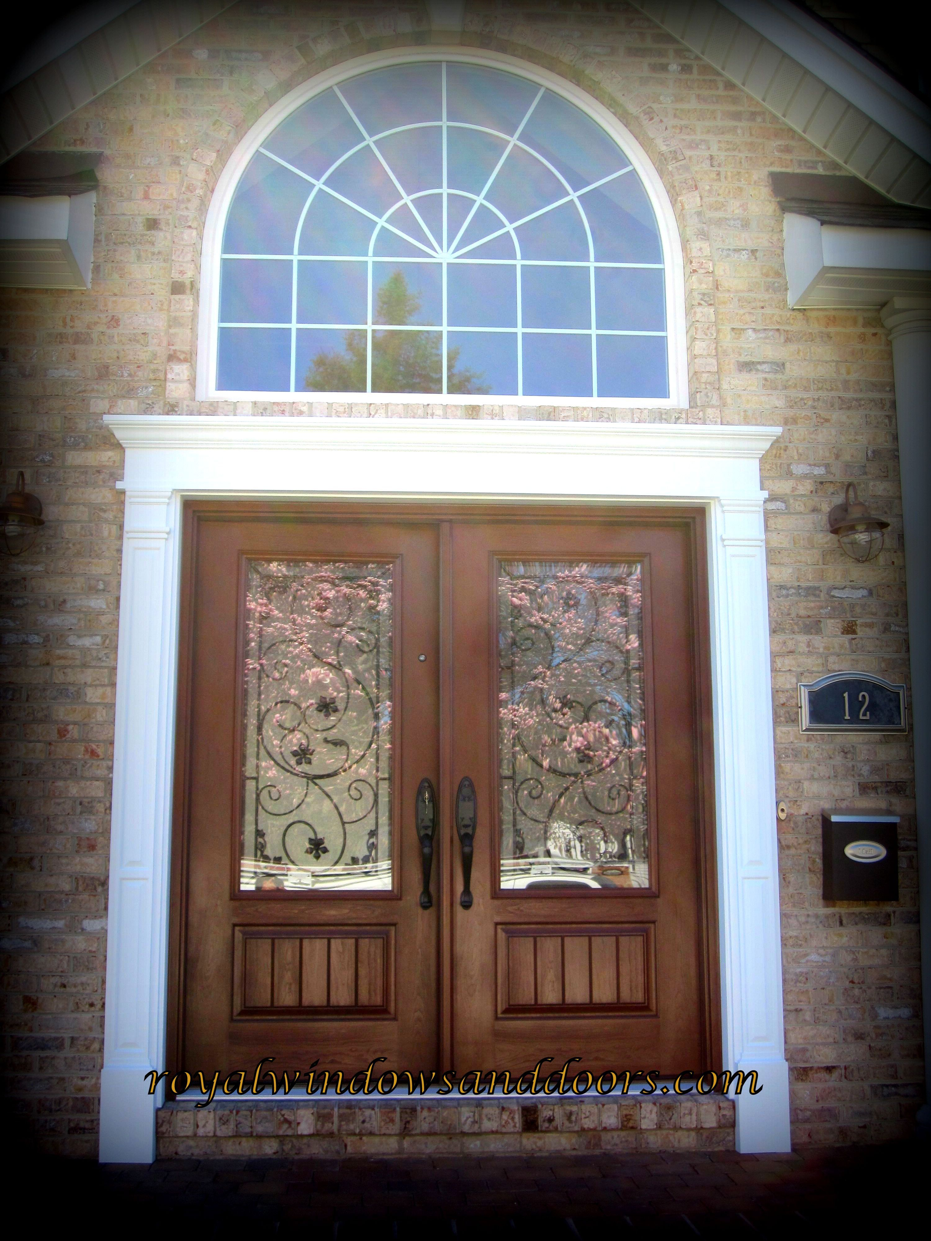 Front door with sidelights and transom - Double Entry Door With Wrought Iron Design The Unit Is In Fiberglass And Painted Wood