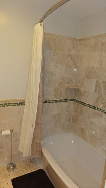 Deep soaker tub shower combo with marble and glass surround ...