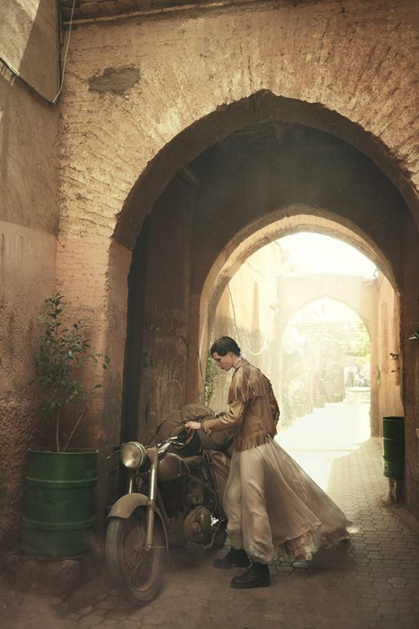 Young lady with her motorcycle in Morocco   US Vogue's June 2013 shoot by well known photographer Peter Lindbergh.