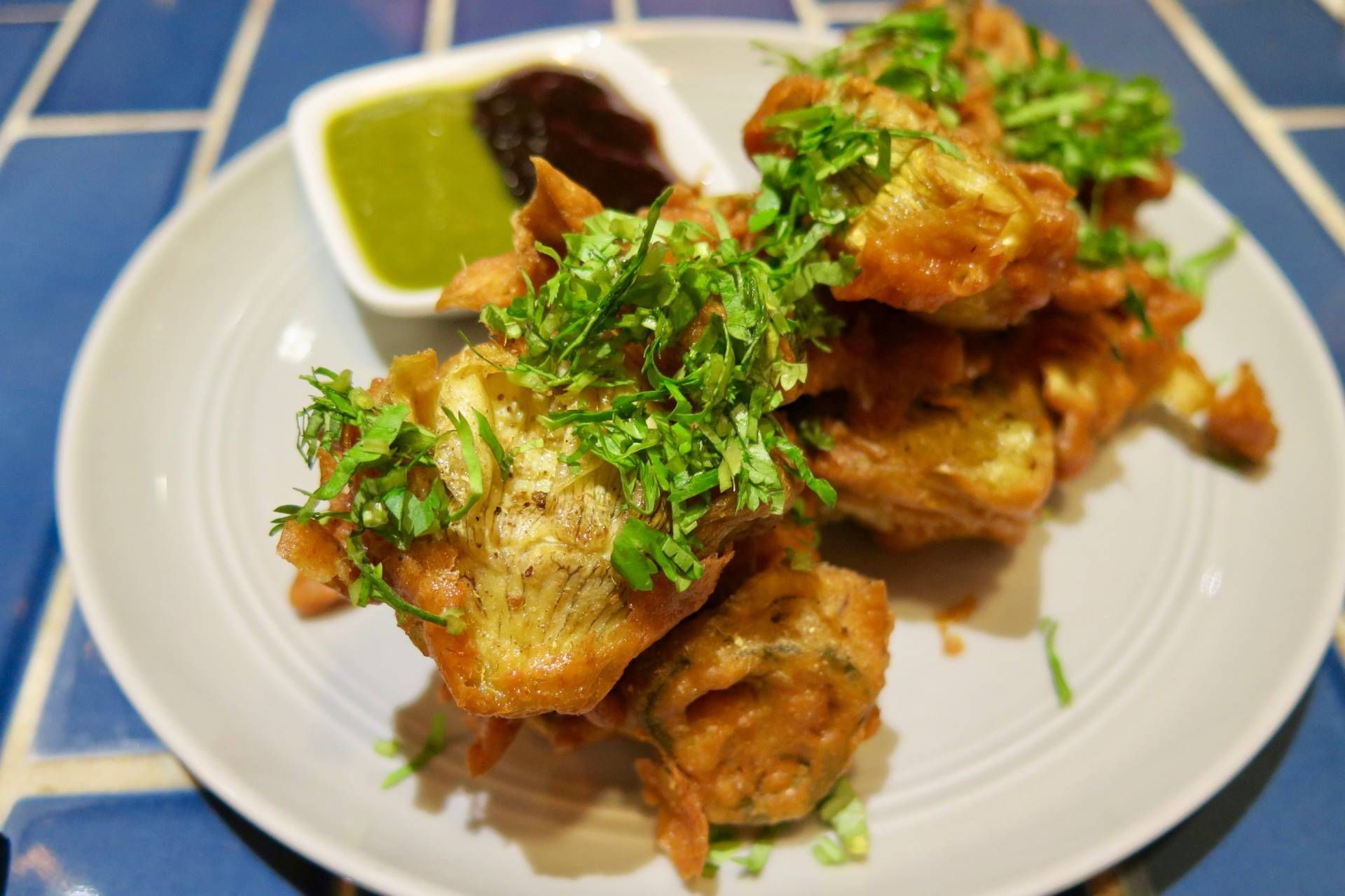 The artichoke pakoras are a great place to start. Soul food