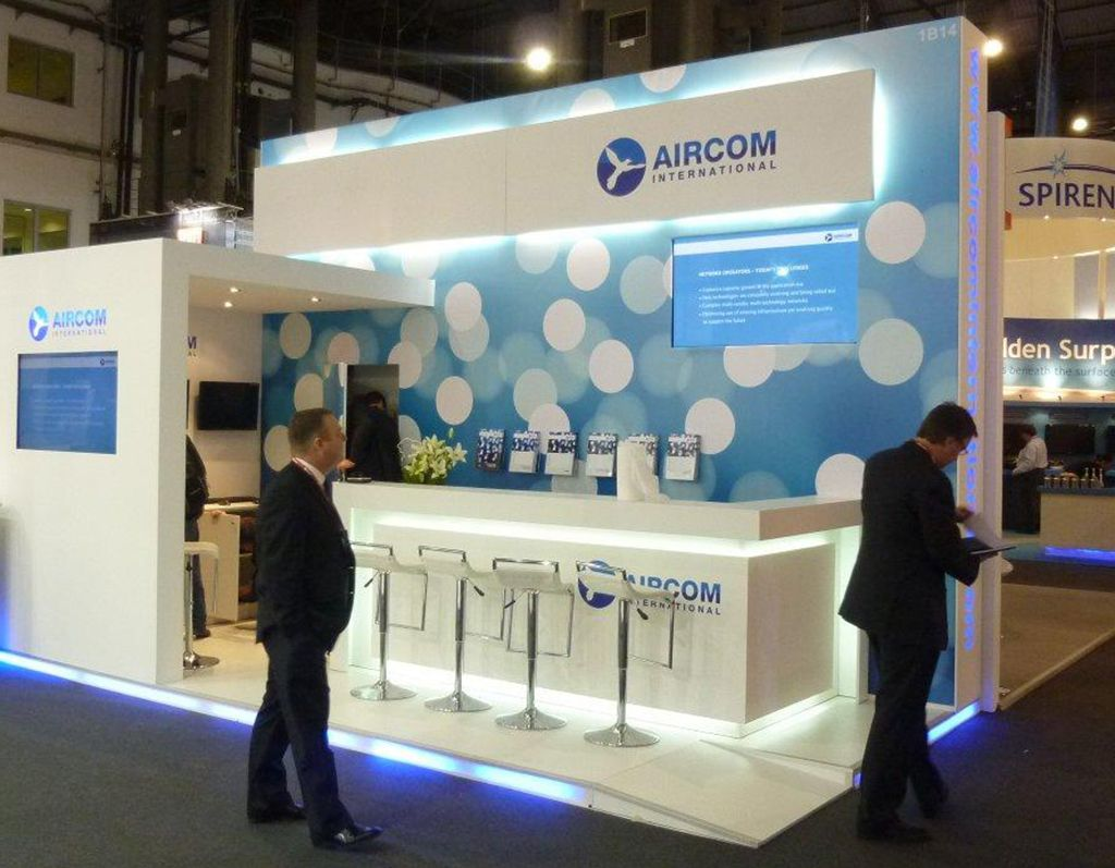 Exhibition Stand Reception : Exhibition stand with abstract graphic on back wall and under lit
