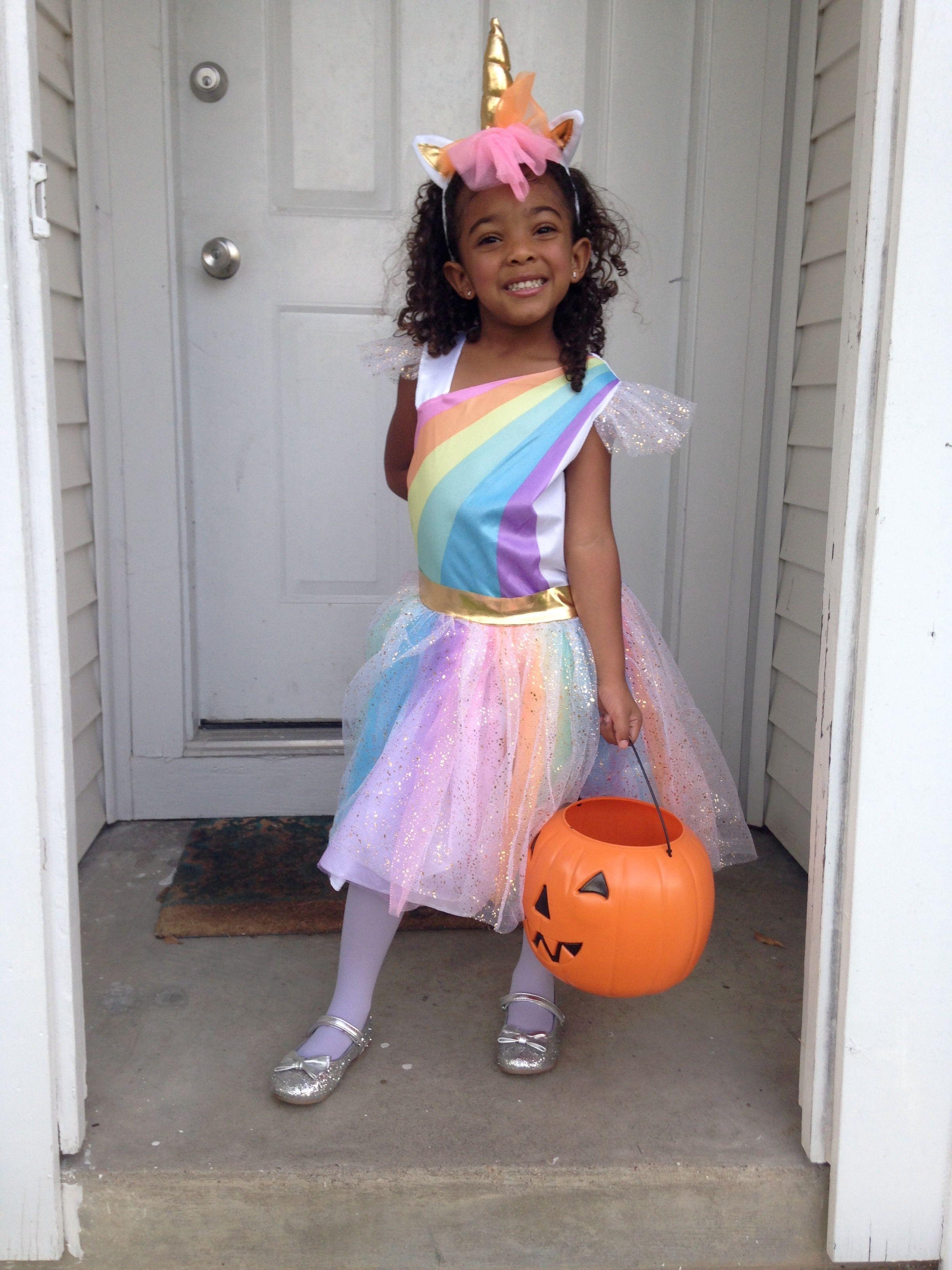 Girls costume: Unicorn, glitter, shimmer and shine.   Girl