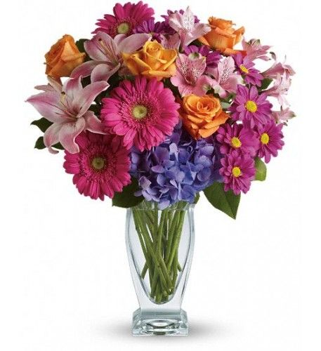Featuring a wide, wondrous assortment of blooms in one bouquet, this colorful arrangement is always a favorite! Hydrangea, roses, lilies, alstroemeria, gerberas, daisies - they're all here in stunning variety.