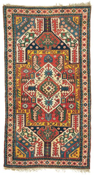 Kasim Ushag Rug from Alebrto Levi Gallery in Italy. Circa 1850. The southern Caucasian Kasim Ushag are all inspired by the early phase of silk Caucasian embroideries. In this finely woven, pristine example, characterised by a brilliant palette, we see a central scorpion-like motif enclosed within a yellow cartouche, flanked by two pairs of curved devices.