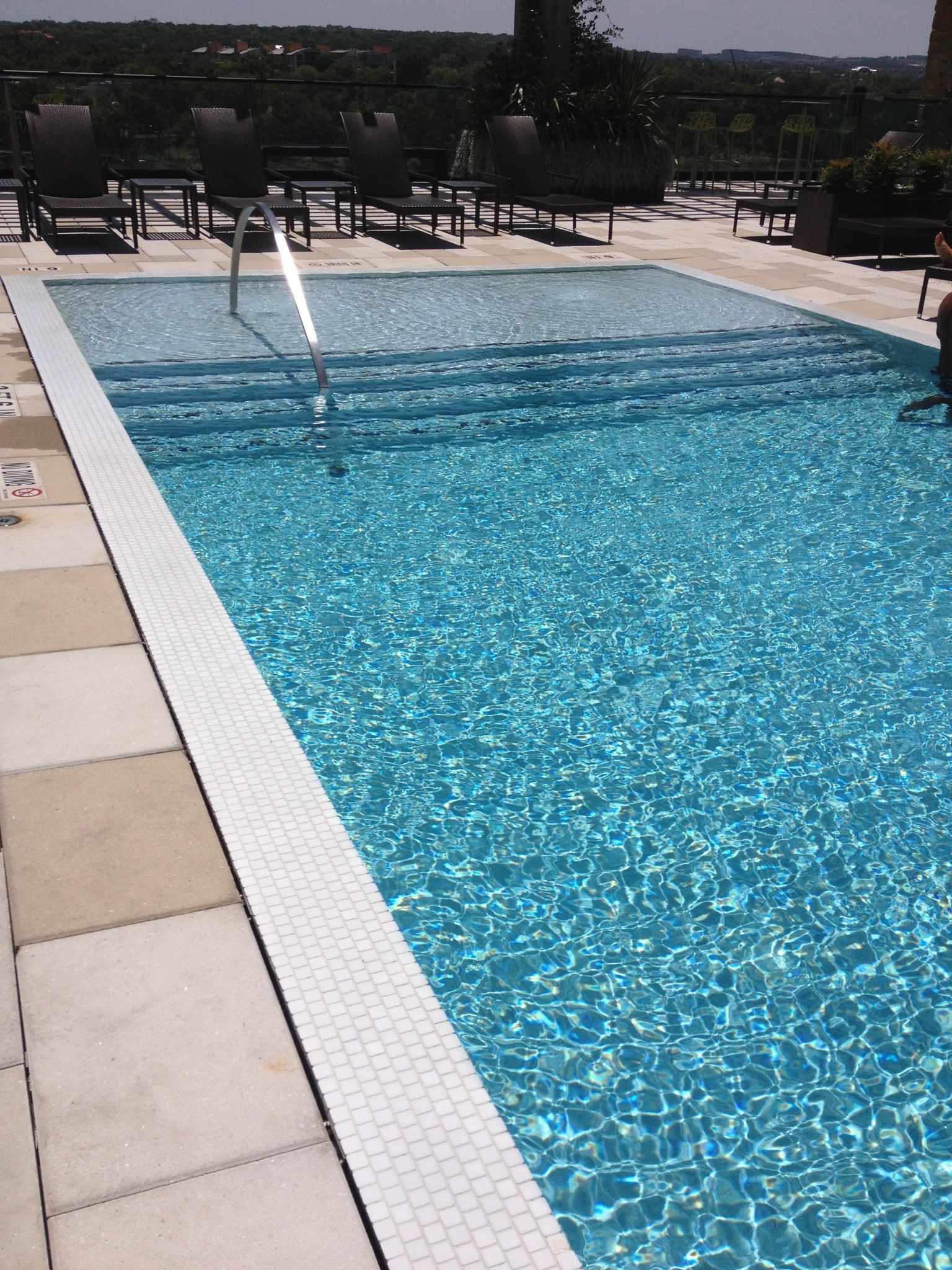 Water level that is even with the pool deck. Has a modern feel and ...