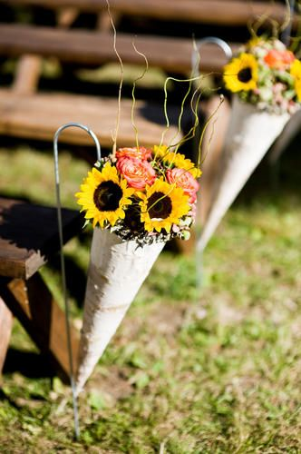 Malloy Events at Private Residence on Lake Sunapee, NH. birch cones filled with antique green hydrangea and sunflowers