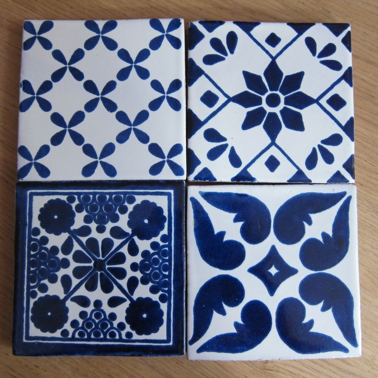 Tin and cobalt handpainted tiles Looks Dutch even though the