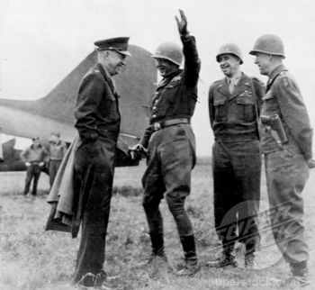 Original caption: 'Three U.S. Army field commanders durring (sic) impromptu conference with supreme commander/Sig. C.', General Dwight D. Eisenhower, General George Patton, General Omar Bradley and General Courtney Hodges, March 31, 1945.    http://www.superstock.com/stock-photos-images/4048-5265