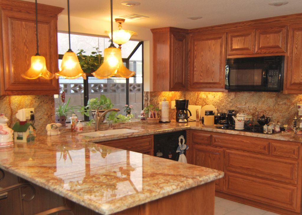 Oak cabinets with Saratoga style doors and drawers. Golden Crystal Granite  with full height grantie
