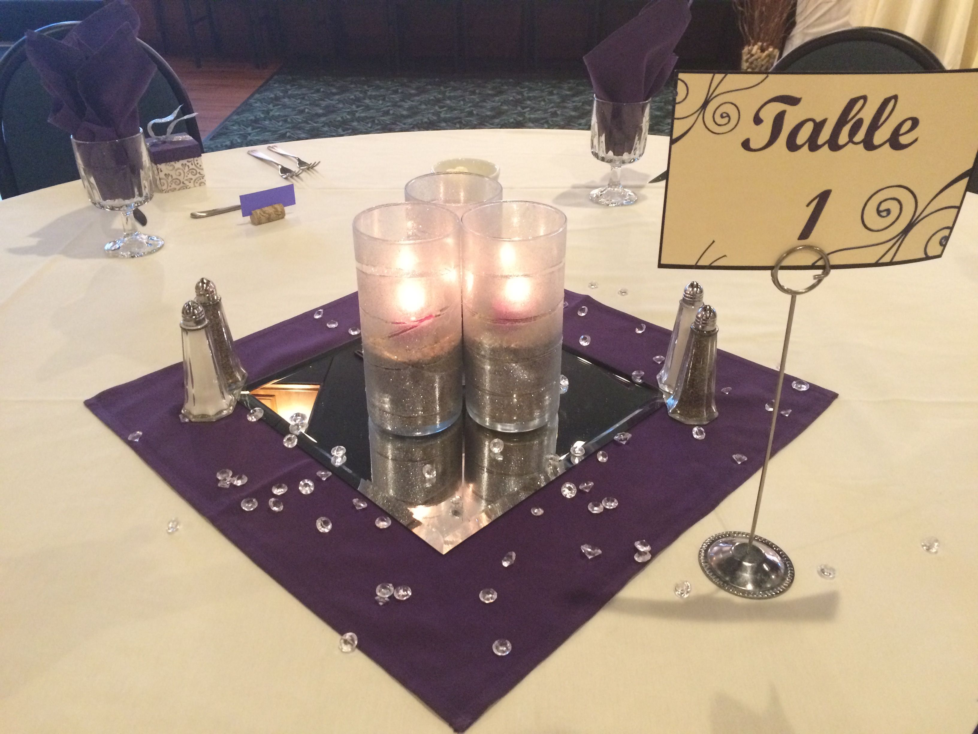 Frosted cylinder vases containing sand and a purple votive purple centerpieces frosted cylinder vases containing sand and a purple votive purple accent napkin mirror tile reviewsmspy