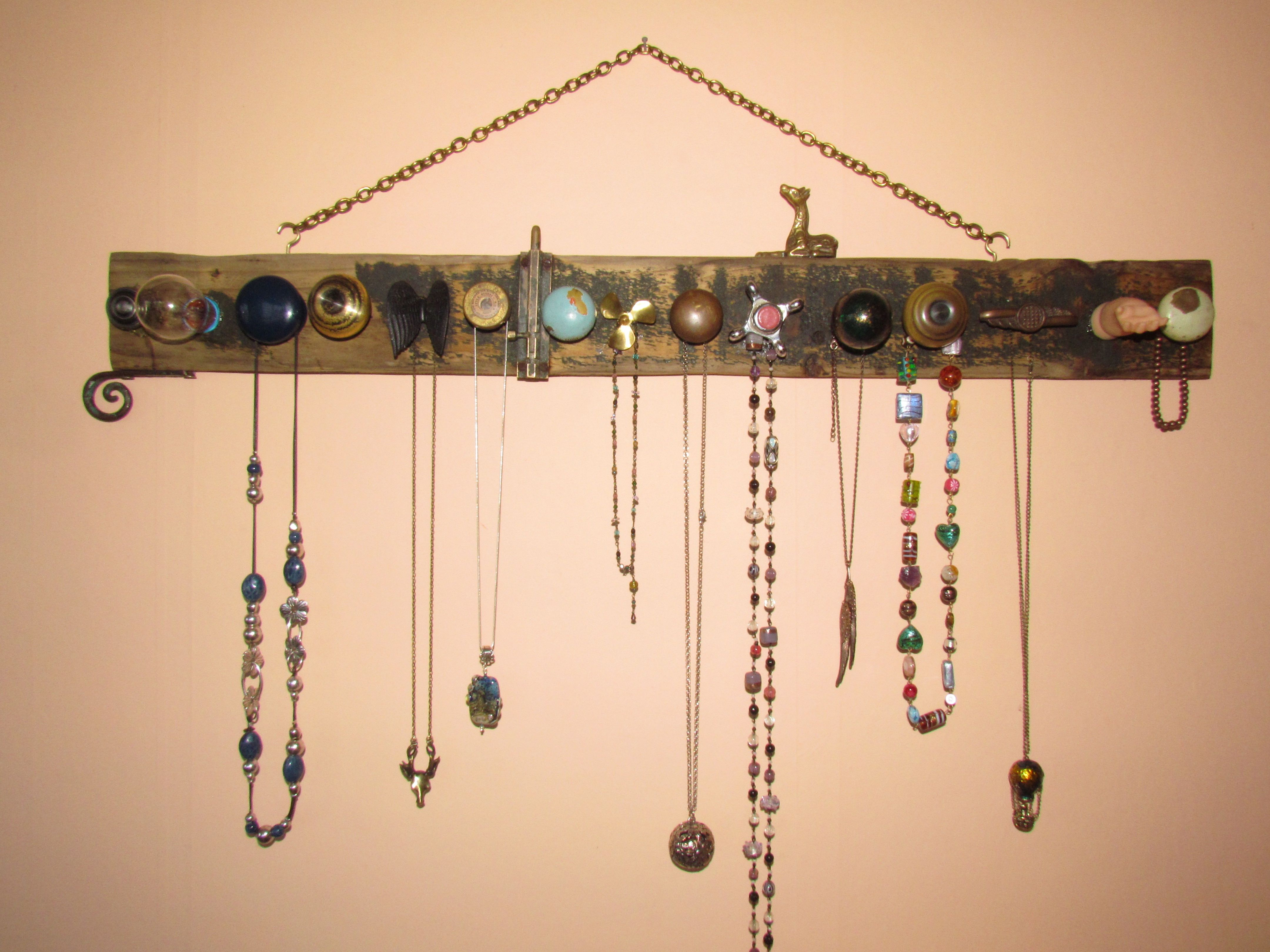Necklace hanger made from old knobs, light bulbs etc